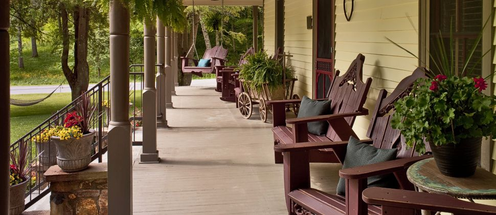porch with chairs and swing